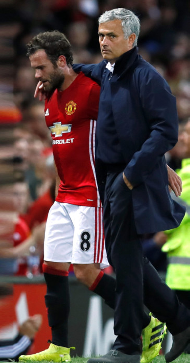 United manager Jose Mourinho puts his arm around Juan Mata after substituting him during Friday's win over Southampton. Pic: Reuters