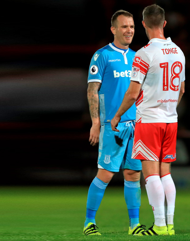 Stoke City's Irish midfielder Glenn Whelan talks to former Potters team-mate Michael Tonge during Stoke's League Cup win at Stevenage in midweek. Photo: PA Wire