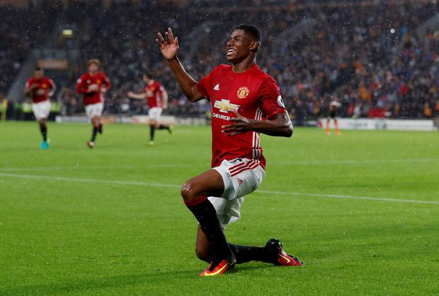 Manchester United substitute Marcus Rashford celebrates his winner against Hull City on Saturday evening. Photo: Lee Smith/Reuters