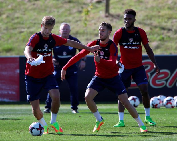 England's Eric Dier, Jordan Henderson and Daniel Sturridge during a training session at St George's Park, Burton.