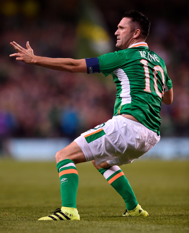 Robbie Keane celebrating after scoring in his last international match
