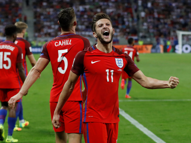 Adam Lallana celebrates his last-ditch goal against Slovakia Photo: Reuters