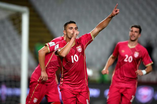 Serbia's Dusan Tadic celebrates scoring his side's second goal of the game from the penalty spot. Pic: PA