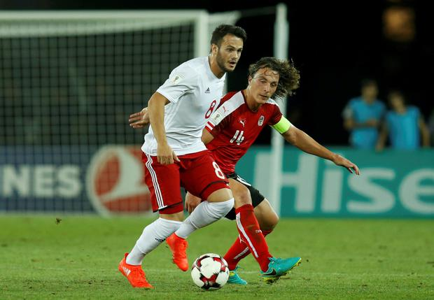 Georgia's Valeri Kazaishvili in action against Austria's Julian Baumgartlinger