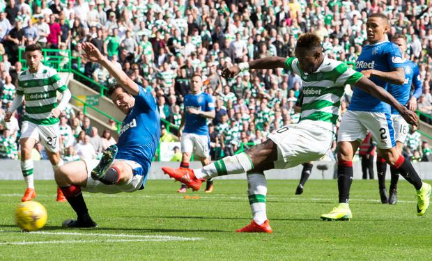 Moussa Dembele scores his third goal in the 5-1 thrashing of bitter rivals Rangers on Saturday