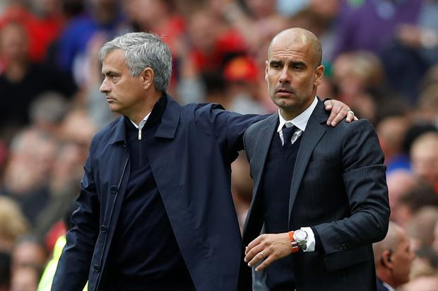 Manchester United manager Jose Mourinho and Manchester City manager Pep Guardiola at the end of last wekend's derby at Old Trafford. Photo: Carl Recine/Reuters