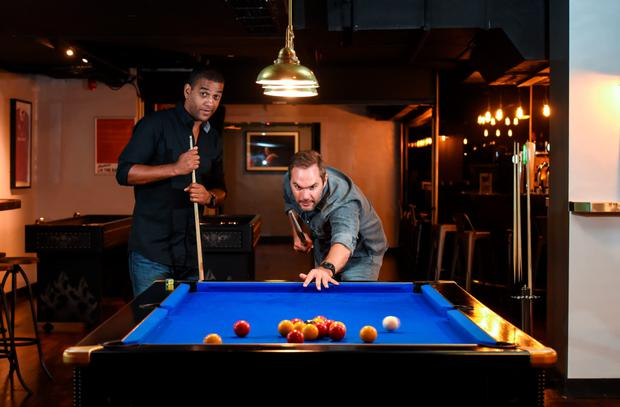 Irish soccer legends Phil Babb, left, and Jason McAteer welcomed guests into Dublin's newest interactive sports bar, Buskers On The Ball, at the Temple Bar Hotel yesterday