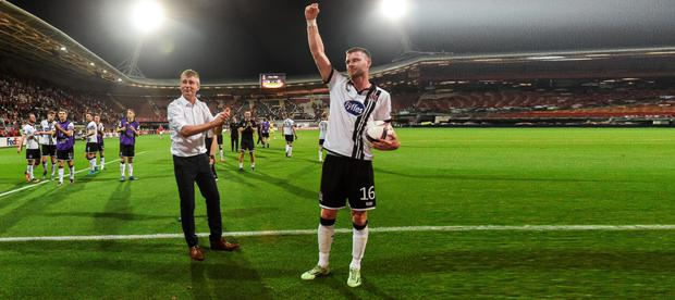 Ciaran Kilduff salutes the Dundalk supporters in the AZ Stadion after the match Picture: Sportsfile