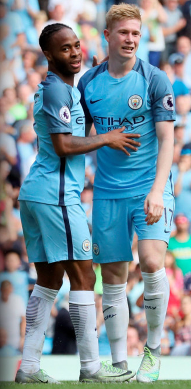 Manchester City's Raheem Sterling and Kevin De Bruyne after their third goal Photo: PA