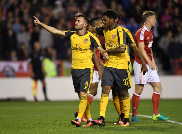 (l-r) Arsenal's Lucas Perez celebrates scoring their third goal with Chuba Akpom. Photo: Reuters/Tony O'Brien