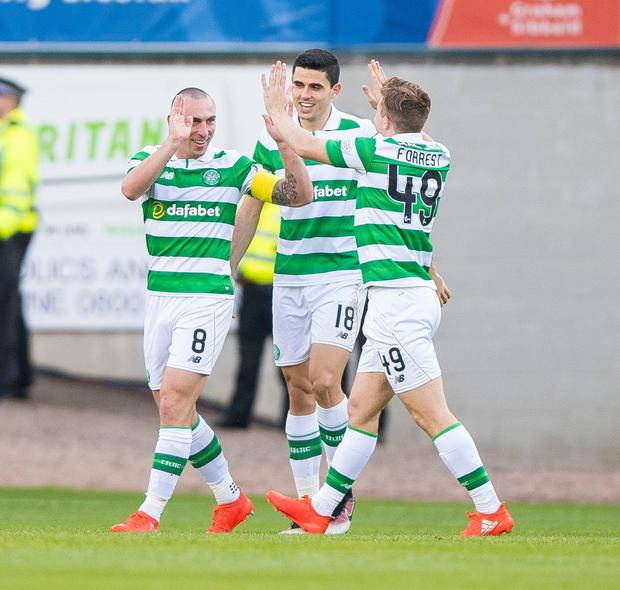 Scott Brown (left) celebrates with team-mates in the win over Dundee on Saturday