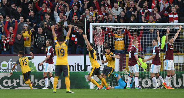 Arsenal players celebrate Laurent Koscielny's late goal