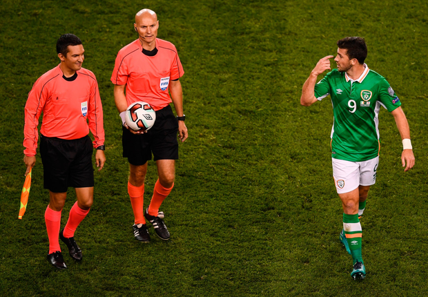 Shane Long has words with the match officials