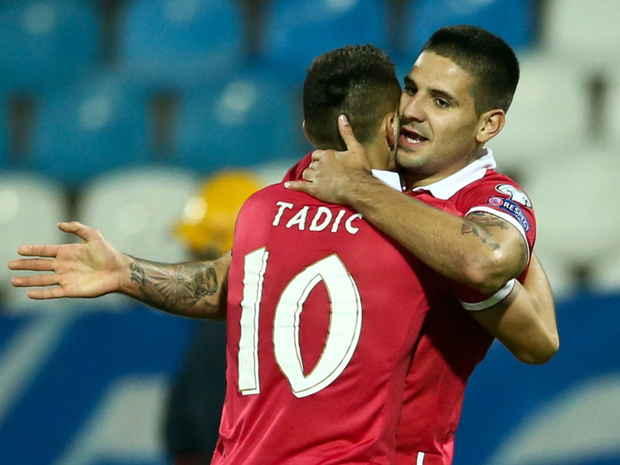 Serbia's Dusan Tadic and Aleksandar Mitrovic celebrate victory over Austria
