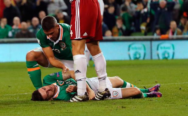 Robbie Brady on the ground after being knocked out cold against Georgia. Pic: PA