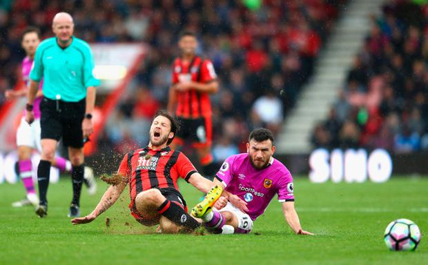 Bournemouth's Harry Arter is fouled by Hull's Robert Snodgrass during their English Premier League clash at the weekend.