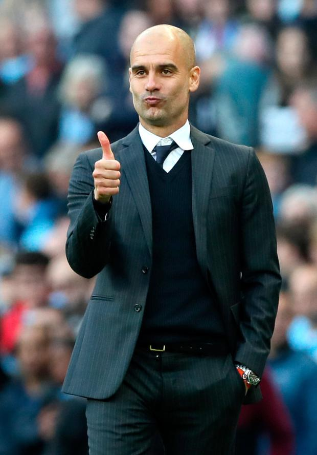 Manchester City manager Pep Guardiola is looking forward to returning to Barcelona for tomorrow night's Champions League clash at the Nou Camp Photo: PA
