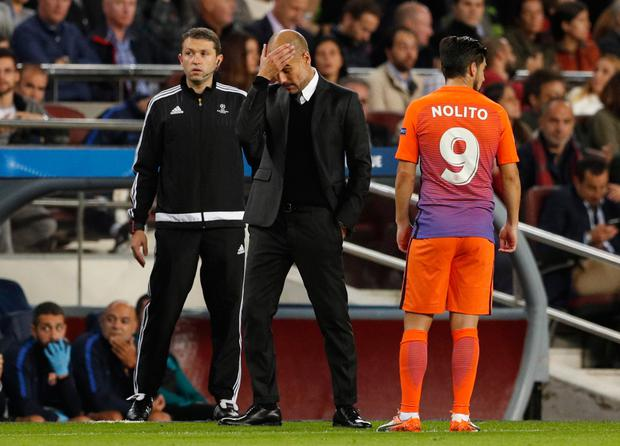 Manchester City manager Pep Guardiola shows his frustration during last night's defeat to his former club Barcelona at the Nou Camp. Pic: Reuters