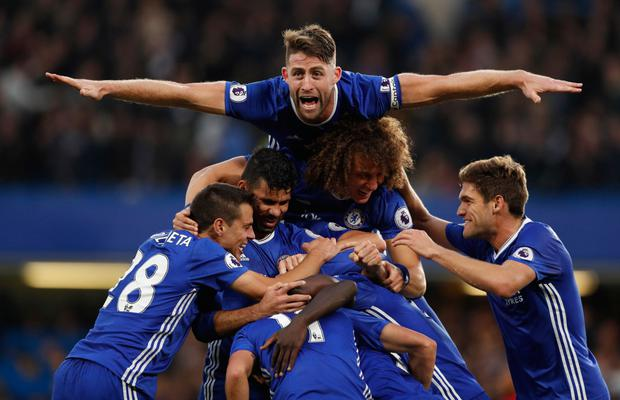 Chelsea players celebrate N'Golo Kante's goal in the 4-0 win over Manchester United Picture: Reuters