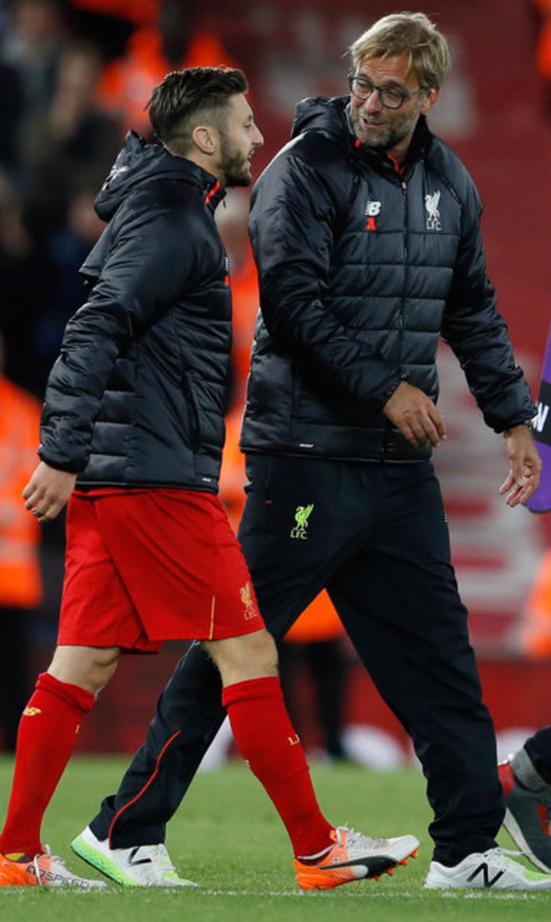 Adam Lallana talks with Liverpool manager Jurgen Klopp during the Premier League victory over West Brom Picture: Reuters