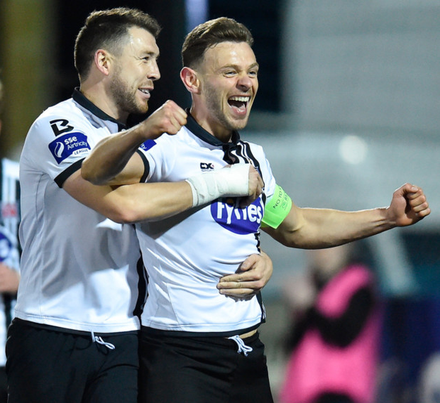 Brian Gartland congratulates Andy Boyle on scoring the first goal against Bohemians on Sunday night that handed them their third successive League of Ireland title