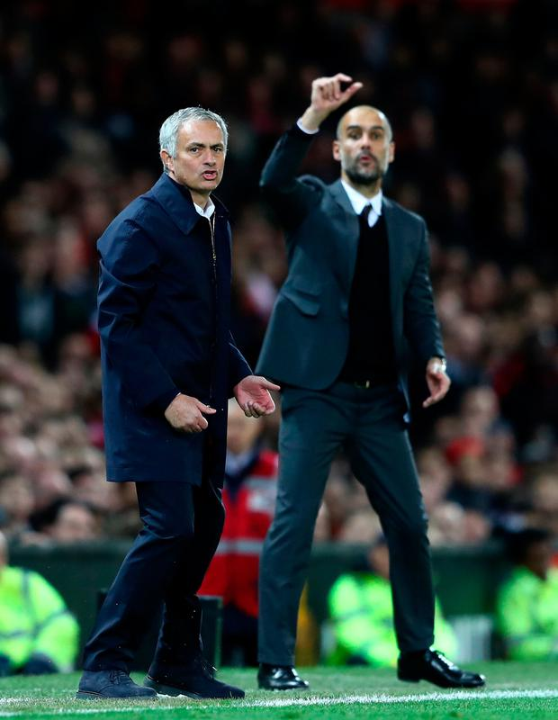 (l-r) Manchester Uniuted manager Jose Mourinho and City boss Pep Guardiola get animated on the sideline during last night's League Cup clash. Pic: Getty Images