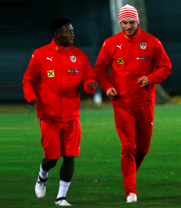 (l-r) Austrian stars David Alaba and Marko Arnautovic chat during a training session in Vienna ahead of Saturday's World Cup qualifier against Ireland. Pic: Reuters