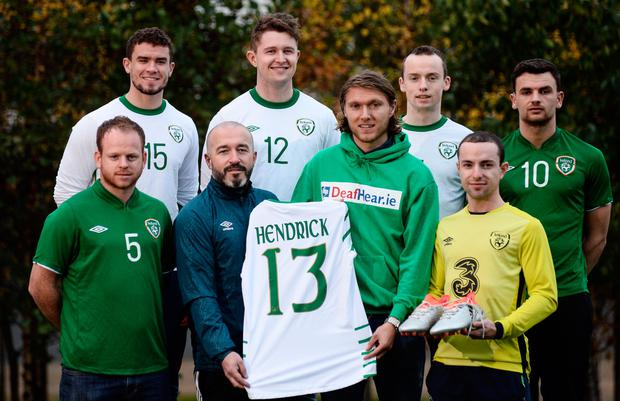 Irish international Jeff Hendrick presents his international jersey and kit which he wore in the European Championship clash with France to Stuart Hayden, manager of the Irish Deaf International soccer team at The Deaf Village in Cabra, Dublin. Pictured with Jeff and Stuart are (l-r) Eamon Byrne, Jason Maguire, Ciaran Lowney, Jeff Hendrick, Adrian McCluskey, Daniel Landers and Sean Young. Pic: Sportsfile