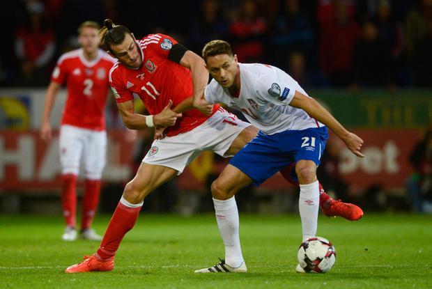 Wales' Gareth Bale in action with Serbia's Nemanja Matic