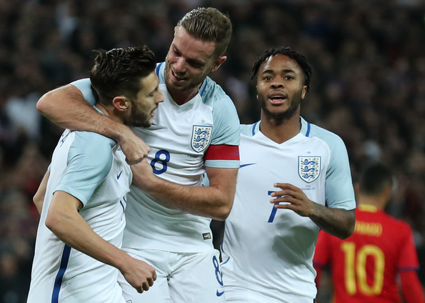England's Adam Lallana celebrates with Jordan Henderson after scoring from the penalty spot