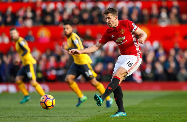 Manchester United midfielder Michael Carrick, in action against Arsenal