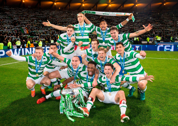 Celtic players celebrate their Scottish League Cup success