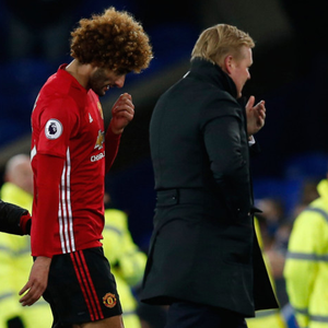 Manchester United substitute Marouane Fellaini talks to Everton boss Ronald Koeman after yesterday's Premier League draw at Goodison Park