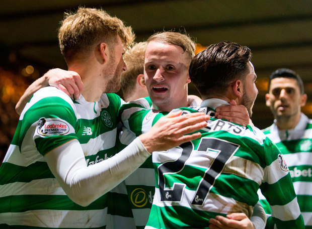 Leigh Griffiths (centre) celebrates scoring Celtic's third goal in the Scottish Premiership win over Partick Thistle last night