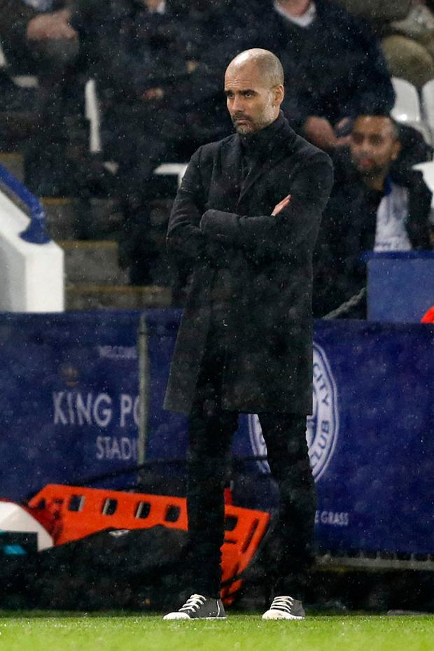 A disappointed City boss Pep Guardiola watches his side get soundly beaten by Leicester