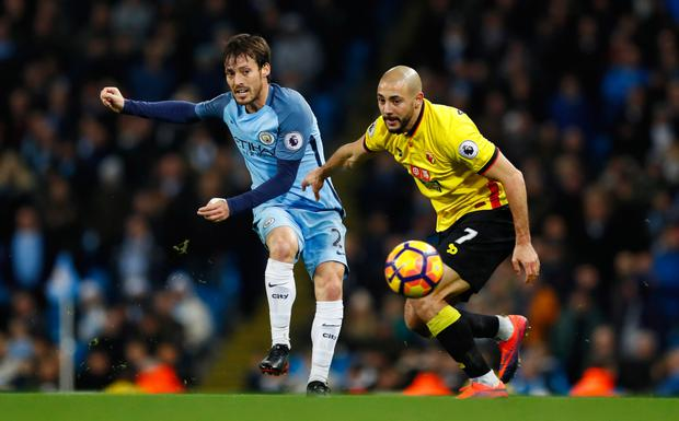 Manchester City's David Silva in action with Watford's Nordin Amrabat