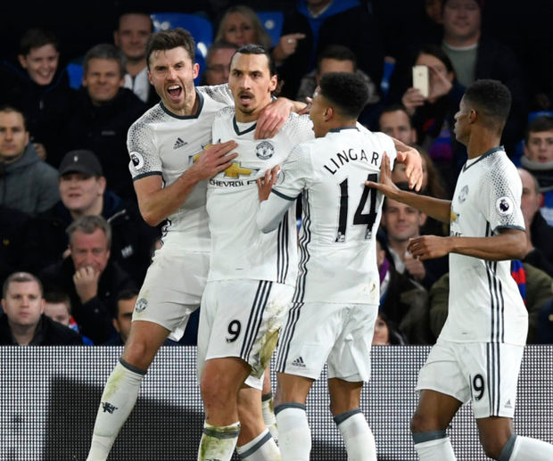Manchester United's Zlatan Ibrahimovic celebrates scoring their second goal with teammates