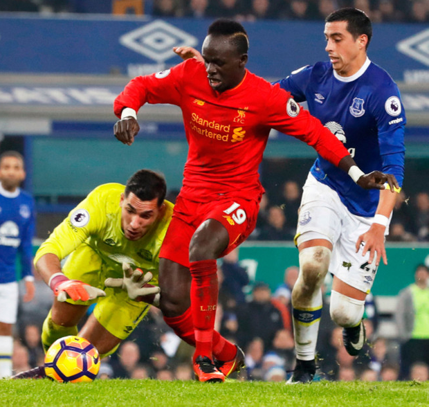 Liverpool's Sadio Mane scores his side's first goal