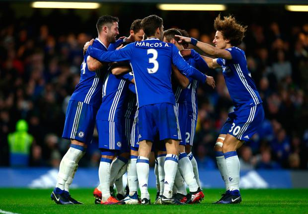Chelsea's Eden Hazard celebrates with teammates after scoring his side's second goal against Bournemouth at Stamford Bridge yesterday.