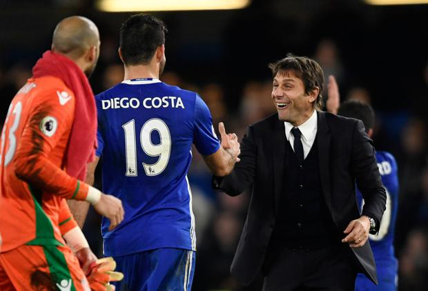 Chelsea's Diego Costa and Chelsea manager Antonio Conte celebrate after the win over Stoke - the Blues' 13th league win in succession.