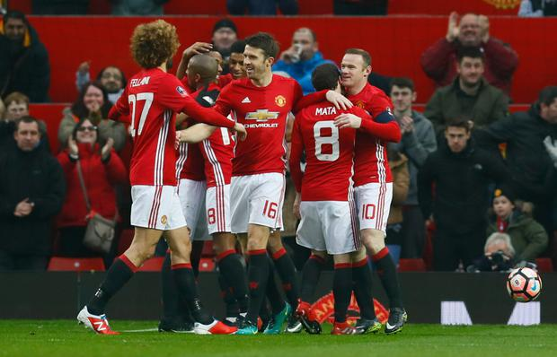 Manchester United's Anthony Martial (centre) celebrates scoring his side's second goal with (l-r) Marouane Fellaini, Ashley Young, Marcus Rashford, Michael Carrick, Juan Mata and Wayne Rooney during the FA Cup 3rd round match at Old Trafford last Saturday. Photo: Reuters