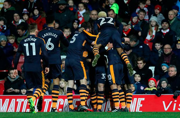 Murphy is mobbed by his team-mates after he bagged the winning goal away to Brentford. Pic: PA