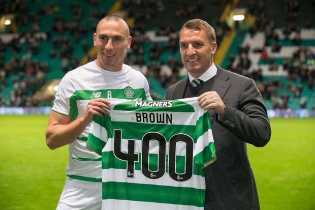 Celtic's Scott Brown collects a shirt from manager Brendan Rodgers for his 400th appearance before the Ladbrokes Scottish Premiership win over St Johnstone at Celtic Park