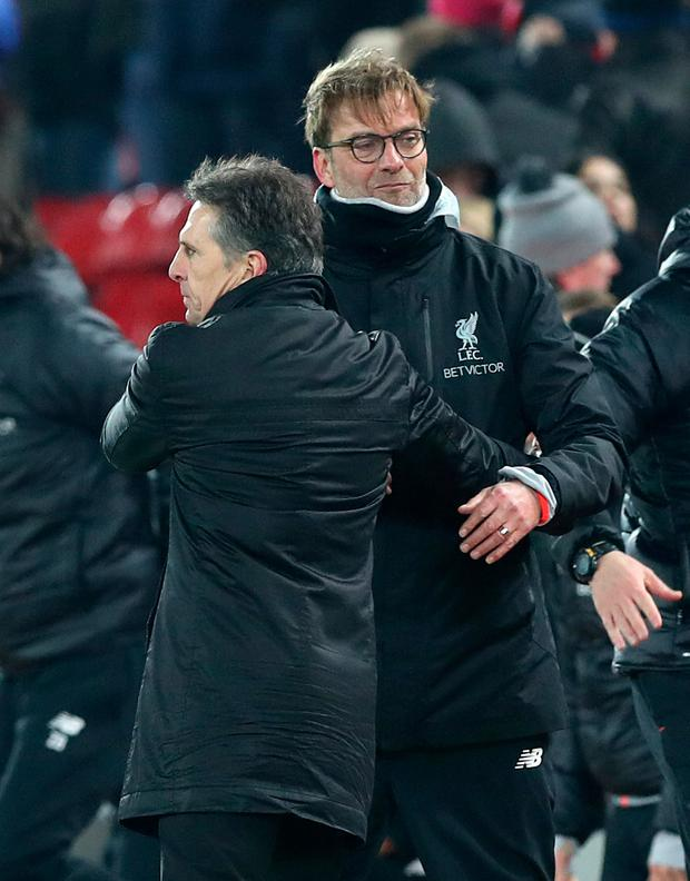 Liverpool manager Jurgen Klopp, pictured here congratulating Southampton manager Claude Puel at the end of Wednesday night's League Cup semi-final second leg, will aim to get back to winning ways tomorrow