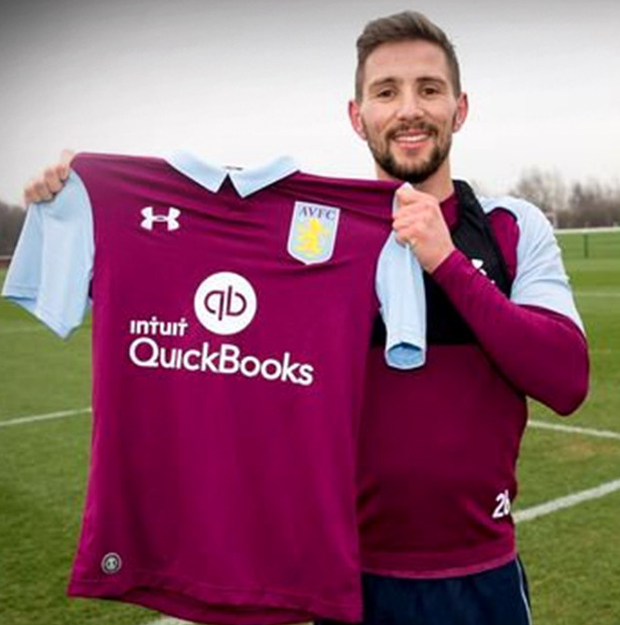 Conor Hourihane with an Aston Villa jersey as he is unveiled by the club