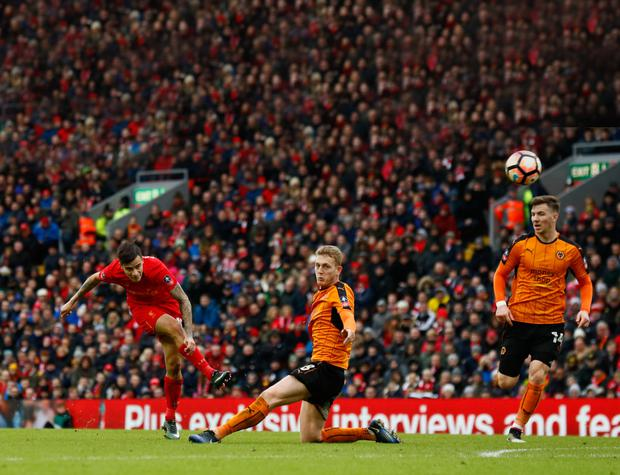 Liverpool's Philippe Coutinho has a shot at goal during Saturday's 2-1 FA Cup loss to Wolves.
