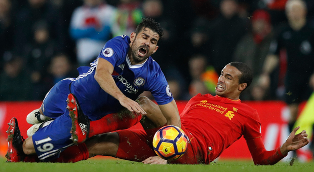 Chelsea's Diego Costa (left) tangles with Liverpool's Joel Matip during the Premier League clash at Anfield