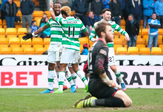 Mousa Dembele celebrates scoring his hat-trick and Celtic's fifth goal in the win at St Johnstone Picture: PA