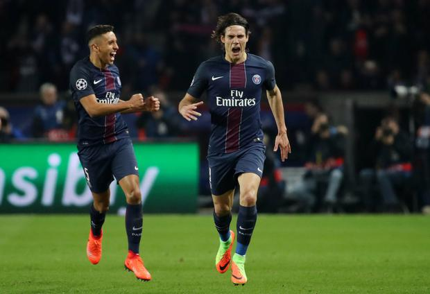 Paris St Germain's Edinson Cavani celebrates scoring their fourth goal in the Champions League last 16 first leg win over Barcelona at the Parc des Princes. Photo: Reuters/Christian Hartmann Livepic