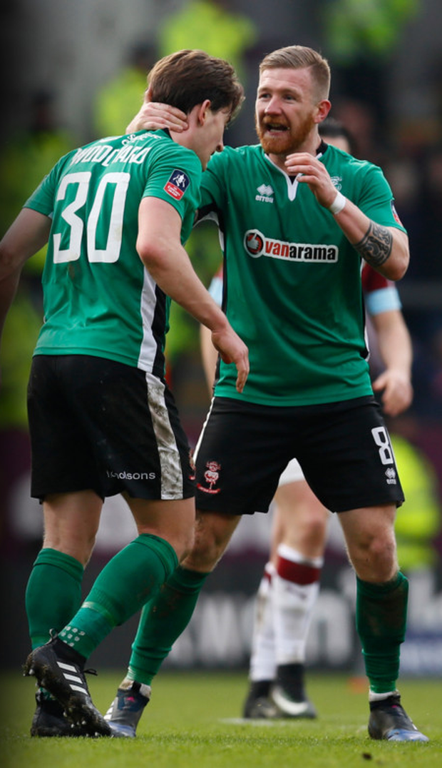 Lincoln's Irish player Alan Power (r) and Alex Woodyard celebrate after their shock success.